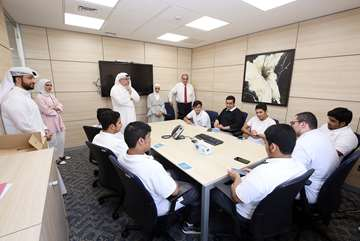 Ahli United Bank hosts students from Abdul Latif Thunian Al Ghanim Secondary School for Boys